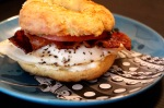 Keto LCHF bagel with egg, bacon, tomato, cream cheese and pesto