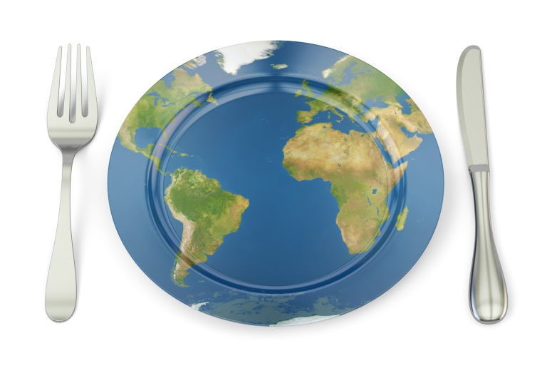 World Map on a plate with fork and knife. International cuisine concept, 3D rendering